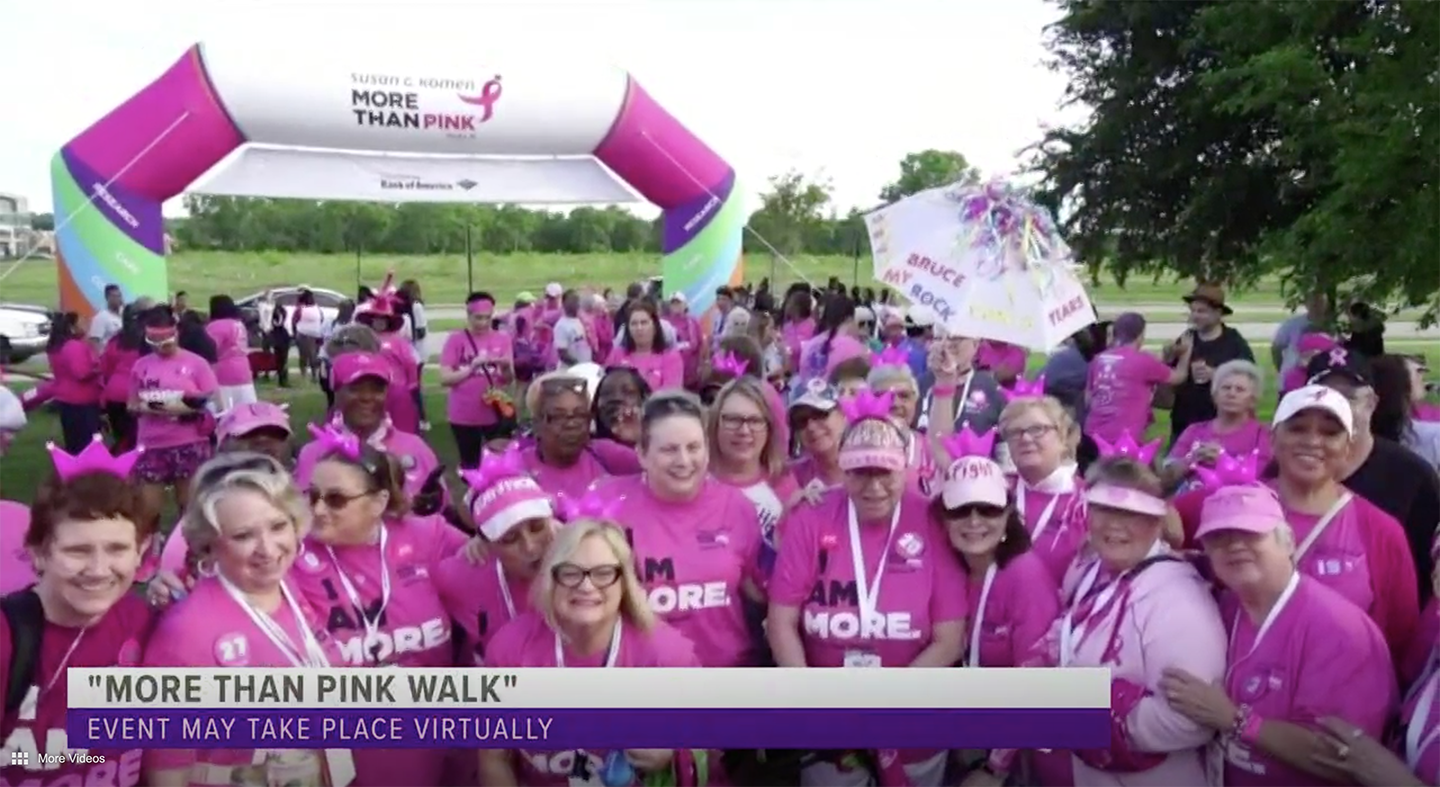Breast cancer survivors gathered in a group at a previous year's More Than Pink Walk
